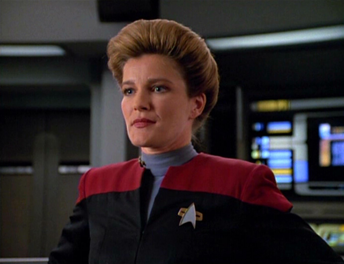 Janeway in her natural habitat contemplating something certifiably insane.